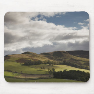 A Landscape With Rolling Hills And Clouds Overhead Mouse Pad