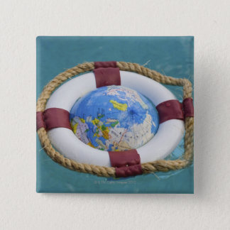 A life preserver and world globe floating 15 cm square badge
