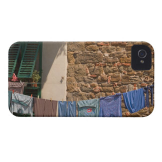 A line of clothes dries between buildings near iPhone 4 cover