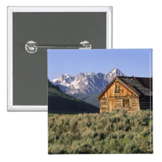 A log cabin and the Sawtooth Mountains in 15 Cm Square Badge