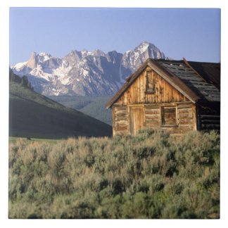 A log cabin and the Sawtooth Mountains in Large Square Tile