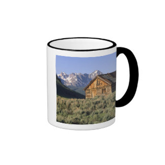 A log cabin and the Sawtooth Mountains in Coffee Mug