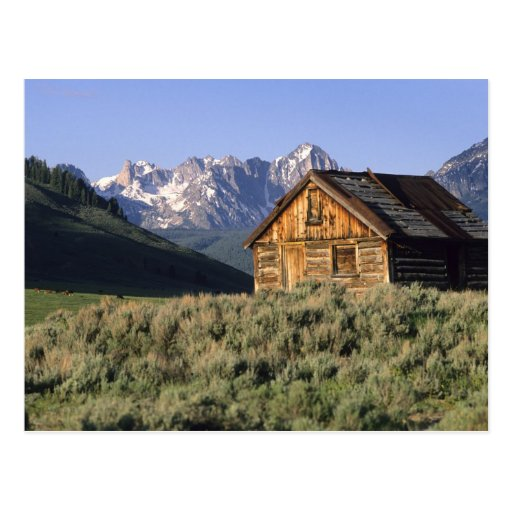 A log cabin and the Sawtooth Mountains in Postcard