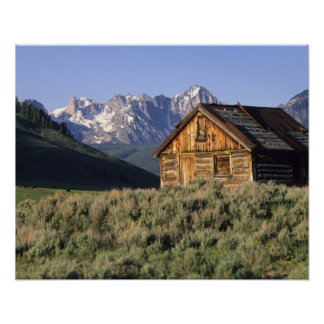 A log cabin and the Sawtooth Mountains in Poster