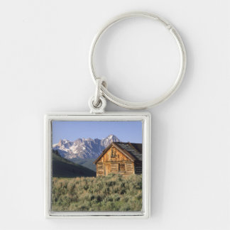 A log cabin and the Sawtooth Mountains in Silver-Colored Square Key Ring