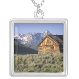 A log cabin and the Sawtooth Mountains in Square Pendant Necklace