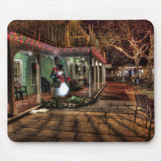 A lone snowman mouse pad