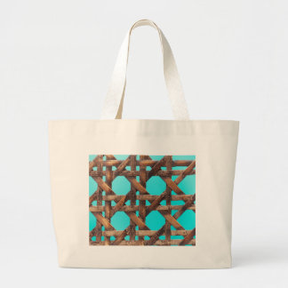 A macro photo of old wooden basketwork. large tote bag