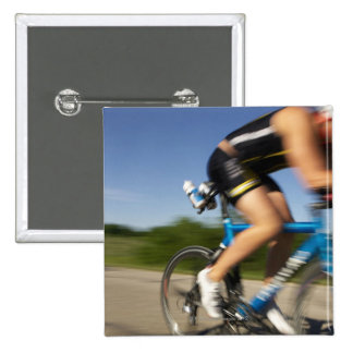 A male athelete training for a triathlon at a 15 cm square badge