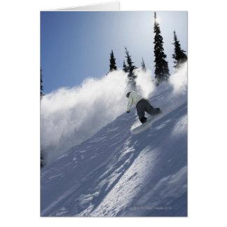 A male snowboarder ripping powder in Idaho. Greeting Card