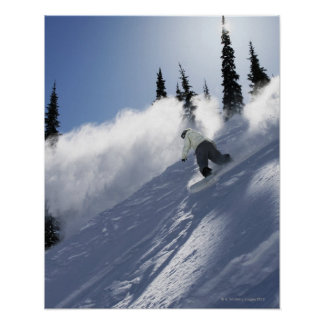 A male snowboarder ripping powder in Idaho. Poster