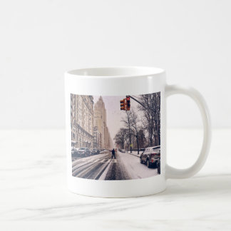 A Man Crossing A Snowy Central Park West Coffee Mug