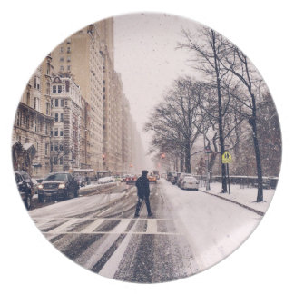 A Man Crossing A Snowy Central Park West Dinner Plate