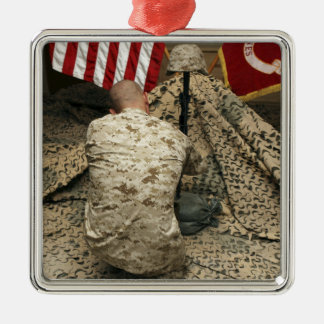 A marine kneels before the rifle metal ornament