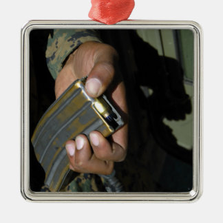 A Marine loads blank ammunition rounds Silver-Colored Square Decoration