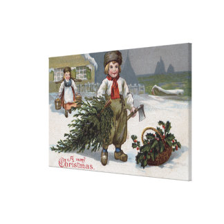 A Merry ChristmasBoy with a Cut Tree Canvas Print