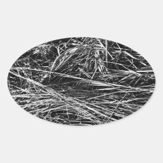 A monochrome photo of grass oval sticker
