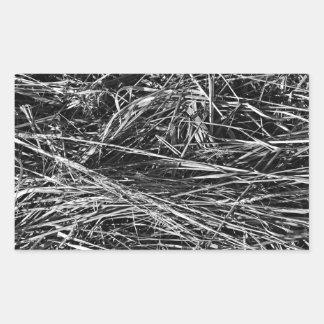 A monochrome photo of grass rectangular stickers
