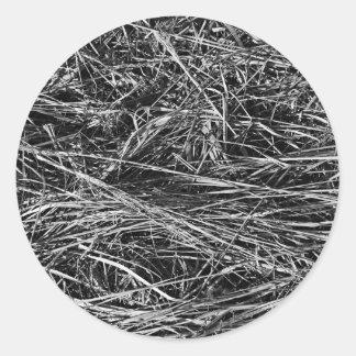 A monochrome photo of grass round sticker