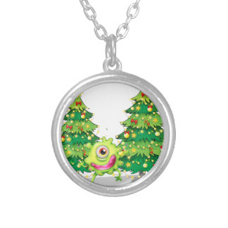 A monster dancing in front of the christmas trees round pendant necklace
