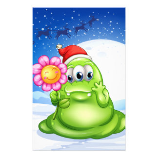 A monster in a snowy land holding a flower personalised stationery