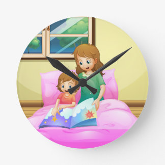A mother reading with her daughter wallclocks