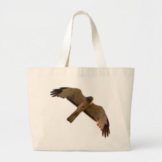 A Northern Harrier soars overhead Large Tote Bag