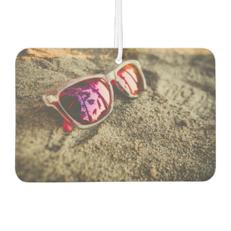 A Pair Of Fashionable Sunglasses On The Beach