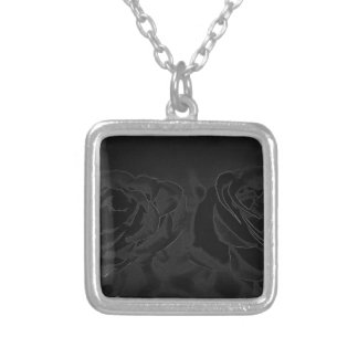 A pair of roses in black silver plated necklace