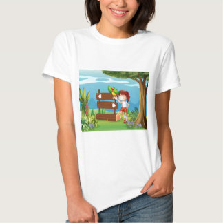 A parrot and a girl beside a signboard in the fore t-shirts