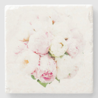 A peony rose on a mat of marble stone coaster