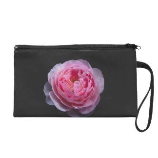 A pink rose flower wristlet