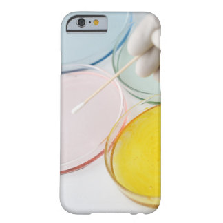 A plastic gloved hand sampling from petrie barely there iPhone 6 case