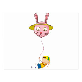 A playful young boy holding a balloon postcard