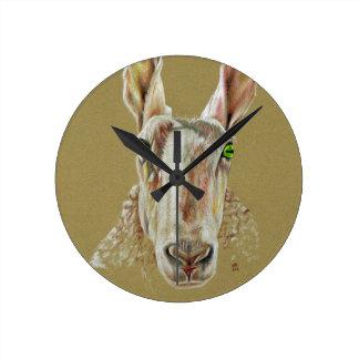 A portrait of a sheep round clock