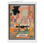 A prince and companions take refreshments and list greeting card