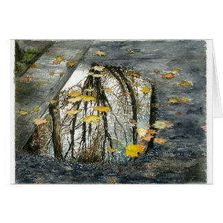 A puddle on the street in November Card