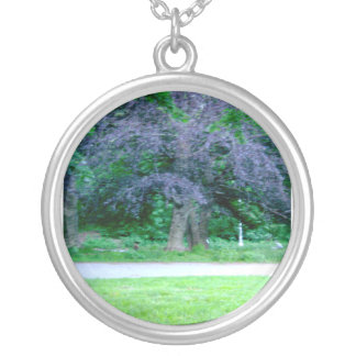 a purple tree necklace