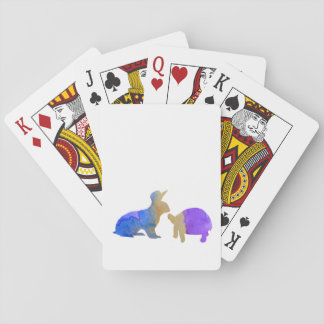 A rabbit and a tortoise playing cards