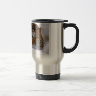 A Rare Amur Leopard Peers Over a Snowy Embankment. Travel Mug