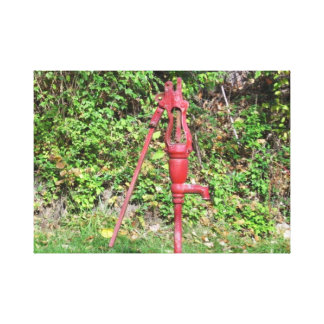 A Red Old Hand Water Pump Canvas Print