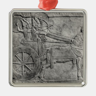 A relief depicting the Assyrian army in battle Metal Ornament