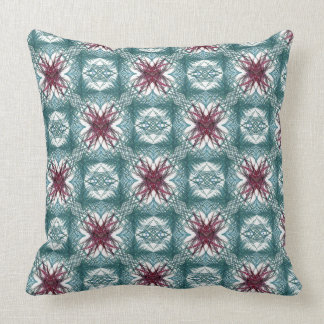 A repeating, fractal pattern in red and turquoise cushion