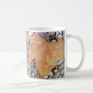 a rusty leaf on pebbles coffee mug