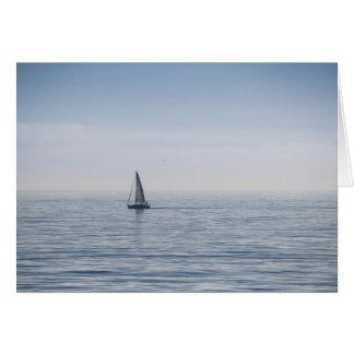 A sailboat on a calm sea card