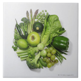 A selection of green fruits & vegetables. ceramic tile