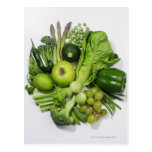A selection of green fruits & vegetables. postcard