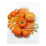 A selection of orange fruits & vegetables. postcard