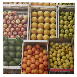 A selection of organic boxed fruit on large square tile