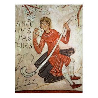 A shepherd playing a flageolet postcard